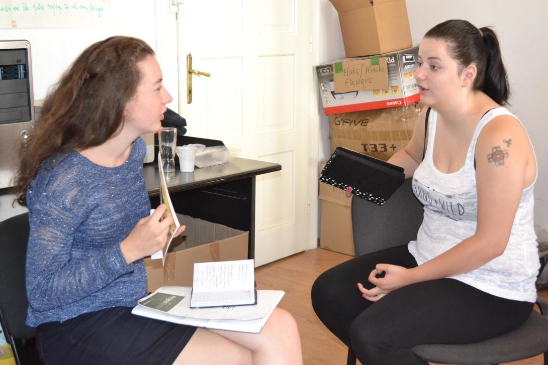 Journalism volunteers practice their interviewing skills as part of their project in Romania